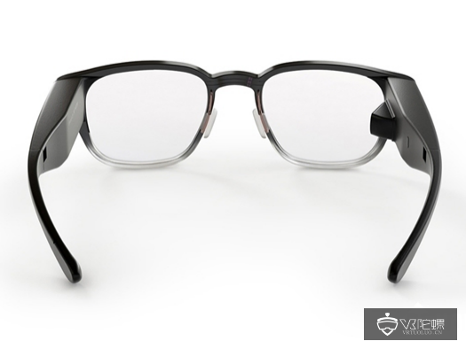 A pair of sunglasses on a tableDescription automatically generated